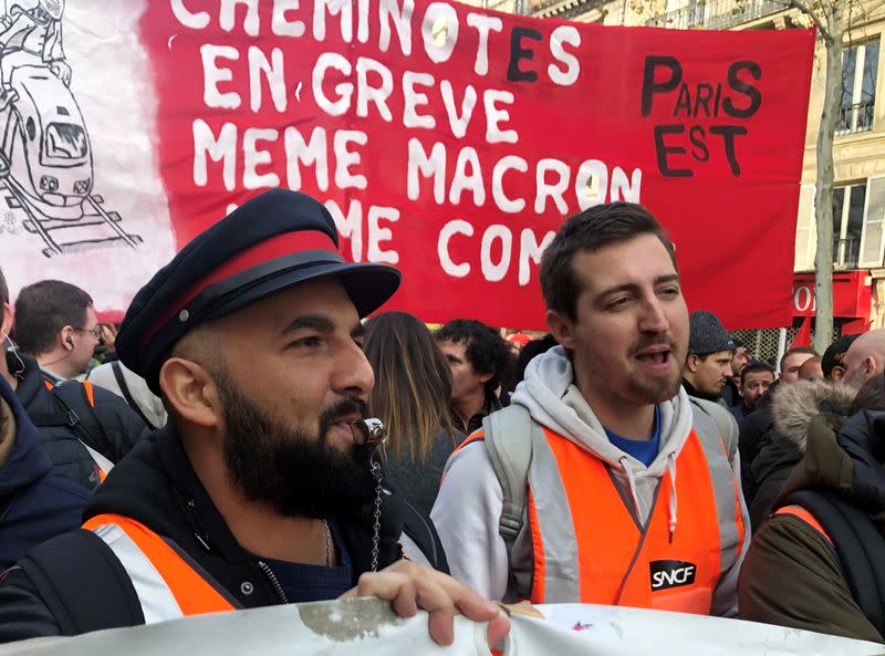 French SNCF railway workers on strike attend a demonstration in Paris