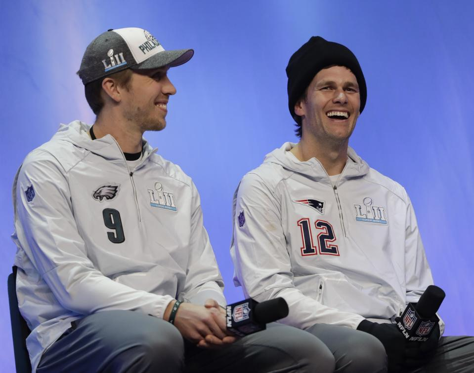 Nick Foles and Tom Brady, shown before Super Bowl LII, will meet again on Thursday night. (AP Photo/Eric Gay)