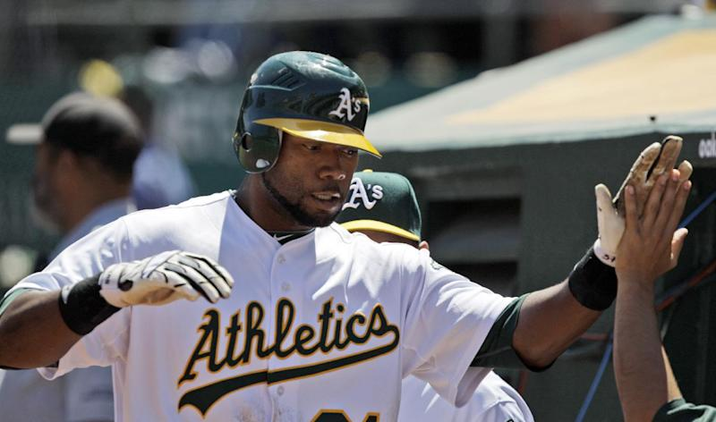 Oakland Athletics' Brandon Allen is high fived by teammates after scoring against the Baltimore Orioles during the third inning of a baseball game in Oakland, Calif.,  Wednesday, Aug. 17, 2011. Allen hit a bases-empty triple on the play then scored on a throwing error. (AP Photo/Marcio Jose Sanchez)