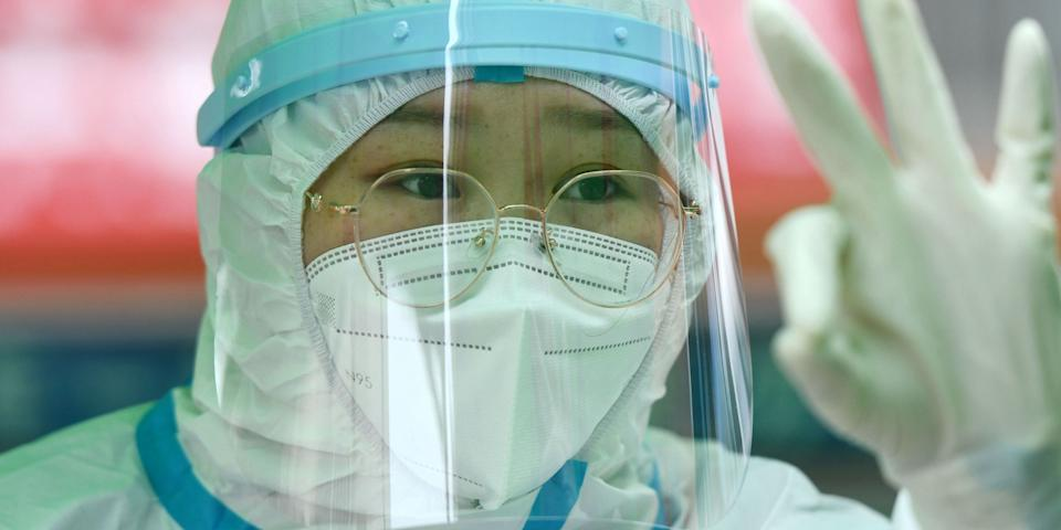 QINGDAO, CHINA - OCTOBER 14, 2020 - A doctor gestured to tell the public that the nucleic acid test was completed. Qingdao, Shandong Province, China, October 14, 2020.- PHOTOGRAPH BY Costfoto / Barcroft Studios / Future Publishing (Photo credit should read Costfoto/Barcroft Media via Getty Images)