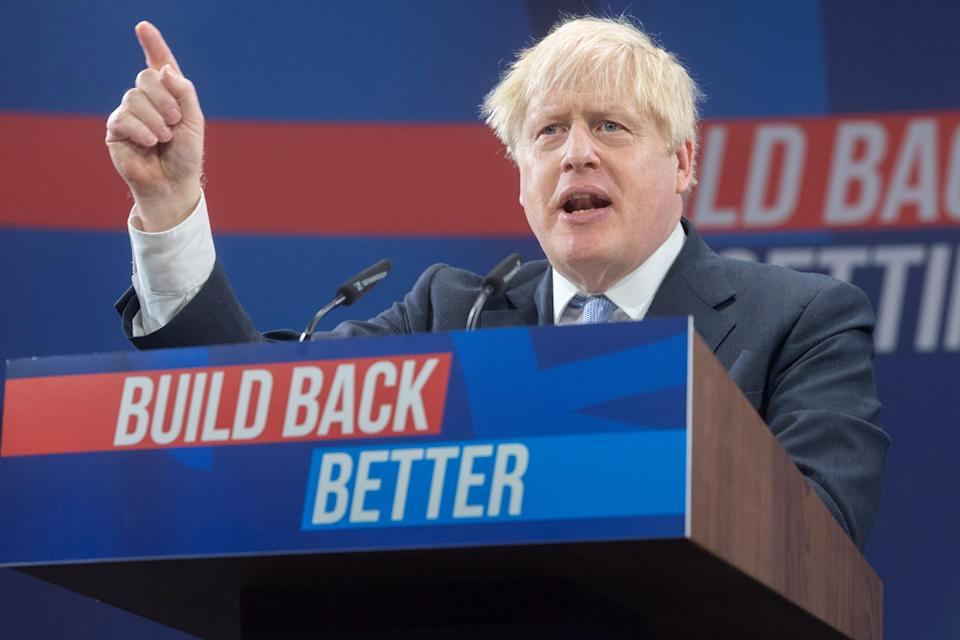 British Prime Minister Boris Johnson makes a speech at the Conservative Party's annual conference in Manchester, Britain, on Oct. 6, 2021. Johnson on Wednesday vowed to change the direction of the British economy, shifting away from its reliance on cheap imported labor, as he shrugged off the ongoing fuel, food and industry crises as