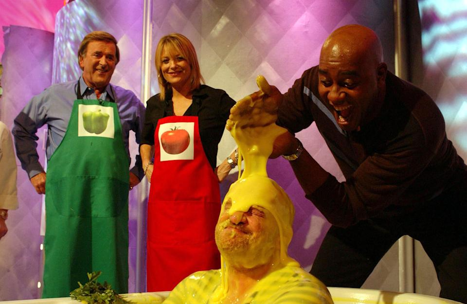 TV chef Anthony Worrall-Thompson gets gunged by fellow chefs Ainsley Harriott as special guests Terry Wogan and Gaby Roslin, look on during a special edition of 'Ready Steady Cook' in aid of 'Children In Need' at Capital Studios, south west London.   (Photo by Andy Butterton - PA Images/PA Images via Getty Images)