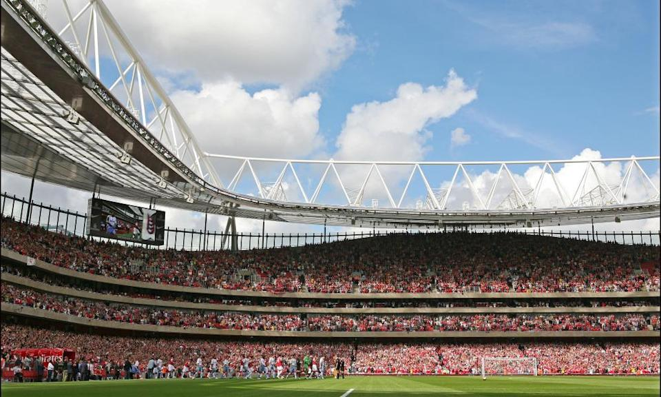 The Arsenal and Aston Villa players take to the pitch in August 2006 for the first competitive match at the Emirates Stadium