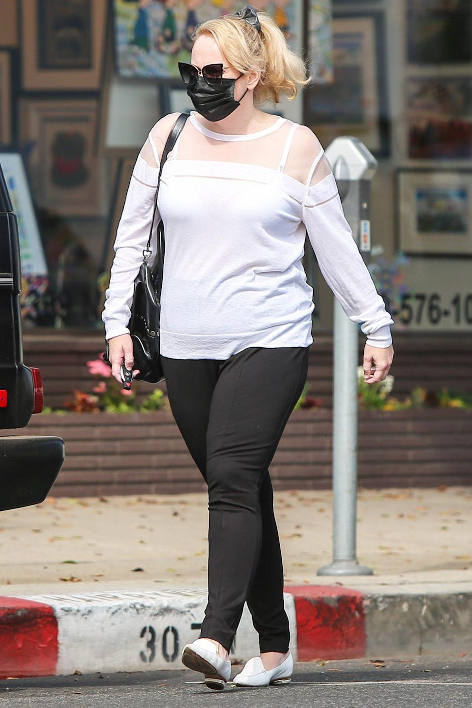 <p>Rebel Wilson is seen out and about in a black-and-white outfit on Tuesday in L.A. </p>