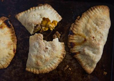"""<div class=""""caption-credit""""> Photo by: Photo by Kimberley Hasselbrink</div><div class=""""caption-title""""></div><b>Apple and Cheddar Meat Pies</b> <br> <br> Cook ground beef and chopped onion until the onion is softened and the beef is no longer pink. Toss with chopped apples and shredded cheddar cheese. Divide a store-bought frozen pie crust into quarters and roll out to make four rounds. Top each round with the beef mixture, brush the edges with water, then fold over, crimping to enclose. Bake in a 425° oven for about 20 minutes."""