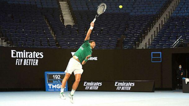 PHOTO: Novak Djokovic of Serbia serves in front of an empty stand in his Men's Singles third round match against Taylor Fritz of the United States during day five of the 2021 Australian Open at Melbourne Park on Feb. 12, 2021 in Melbourne, Australia. (Quinn Rooney/Getty Images)