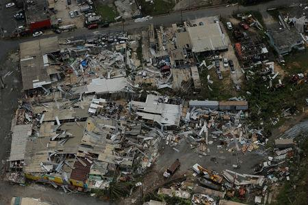 Aluminum roofing is seen twisted and thrown off buildings as recovery efforts continue following Hurricane Maria near San Jose, Puerto Rico