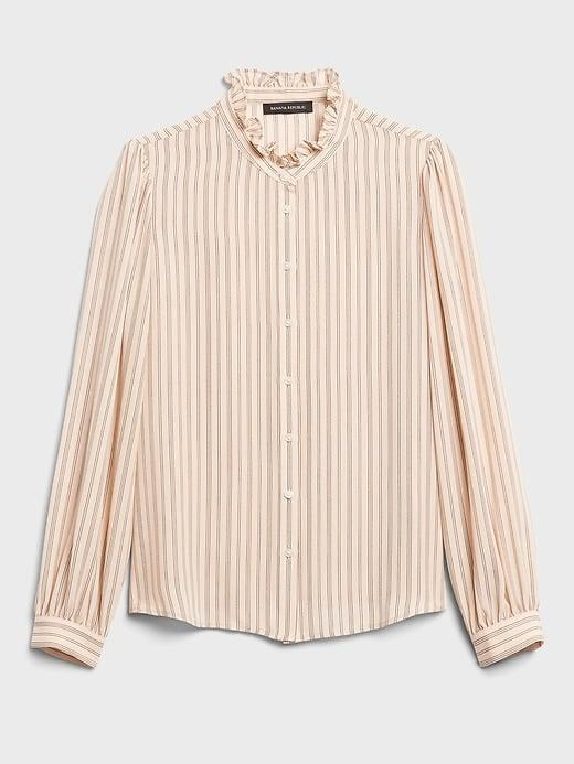 <p>Pair this <span>Banana Republic Ruffle-Collar Shirt</span> ($47, originally $80) with a distressed pair of light denim for a cottage core style.</p>