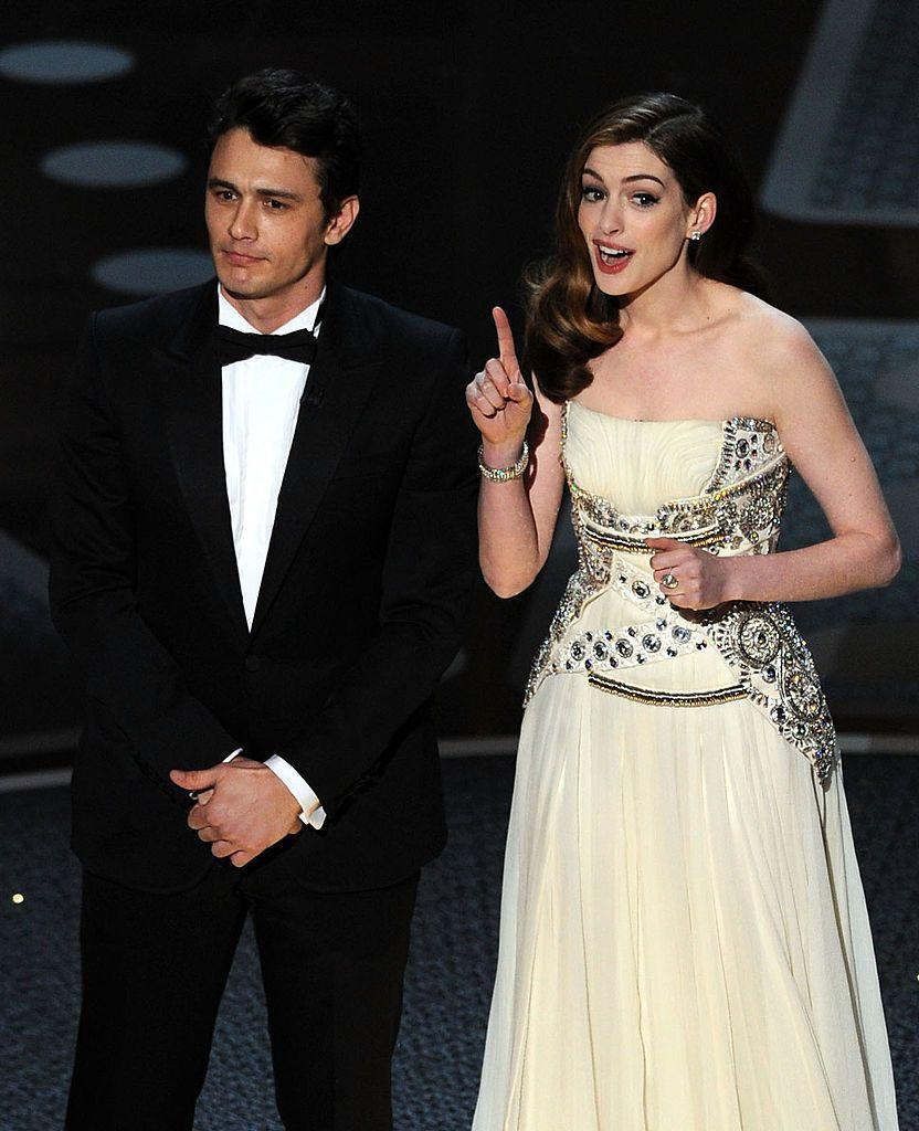 """<p>If you're to research rankings on Oscars hosts, you'll unfortunately likely find <a href=""""https://www.elle.com/uk/fashion/celebrity-style/articles/g16636/anne-hathaway-s-best-looks/"""" rel=""""nofollow noopener"""" target=""""_blank"""" data-ylk=""""slk:Anne Hathaway"""" class=""""link rapid-noclick-resp"""">Anne Hathaway</a> and James Franco quite far down on the list. An immediate review from<a href=""""https://www.hollywoodreporter.com/review/franco-bombs-at-oscars-makes-162234"""" rel=""""nofollow noopener"""" target=""""_blank"""" data-ylk=""""slk:The Hollywood Reporter"""" class=""""link rapid-noclick-resp""""> The Hollywood Reporter </a>called the idea to have Franco and Hathaway host the show 'spectacularly bad' and predicted the gig could go down as 'the worst Oscars telecast in history'.</p><p>In what was described as a move to broaden the Academy Awards' appeal to younger voters, the two actors were selected to host the awards. Having appeared in different films and with no clear friendship, it seemed an odd choice which was confirmed recently in a behind-the-scenes article on <a href=""""https://www.theringer.com/movies/2021/4/14/22381783/2011-oscars-james-franco-anne-hathaway-behind-the-scenes-story"""" rel=""""nofollow noopener"""" target=""""_blank"""" data-ylk=""""slk:The Ringer"""" class=""""link rapid-noclick-resp"""">The Ringer</a> where writer of that Oscars show, David Wild called it an 'incredibly dark significant comic event in my life'.</p><p>In a 2019 <a href=""""https://twitter.com/EW/status/1094605658362703875?s=20"""" rel=""""nofollow noopener"""" target=""""_blank"""" data-ylk=""""slk:People"""" class=""""link rapid-noclick-resp"""">People</a> interview, Hathaway claimed she had turned the interview down at first but was persuaded by Franco to do it.</p><p>'When all the dust settled, I was just like """"You've got to be kidding me"""". Your first instinct is usually the right one, and all the reasons why I turned it down came true.'</p>"""