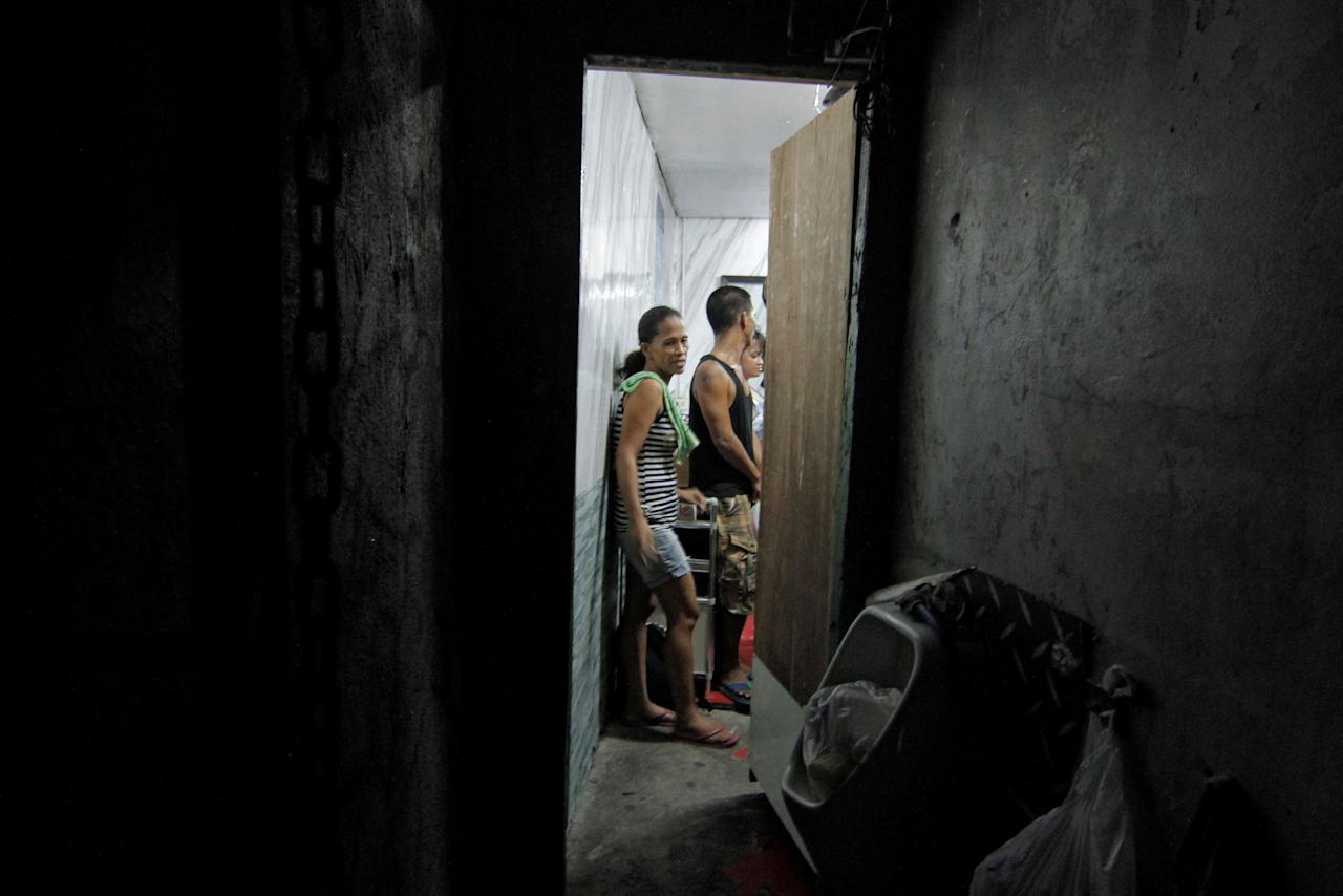 Detainees are pictured inside a hidden room at a police station in Manila, Philippines April 27, 2017.   Picture taken April 27, 2017.  REUTERS/Vincent Go
