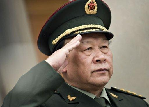 Chinese Defense Minister Gen. Liang Guanglie salutes as China's national anthem is played during an honor cordon at the Pentagon. The Pentagon hosted Liang in a bid to boost military ties as the United States tried to contain the fallout from a diplomatic dispute over a top Chinese dissident