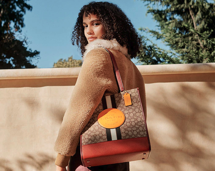We've got an exclusive code to save you $10 on your next Coach Outlet order. Image via Coach Outlet.