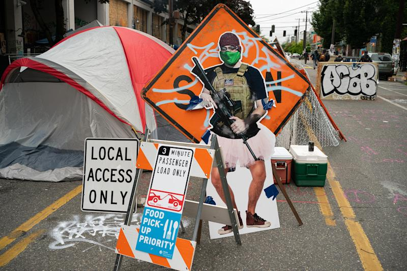 "SEATTLE, WA - JUNE 29: A cutout image of a man holding a firearm, called ""ANTI-FAiry"" and created by activists to critique the recent manipulation and misleading use of the man's image by Fox News, is seen at an entrance in the area known as the Capitol Hill Organized Protest (CHOP) on June 29, 2020 in Seattle, Washington. Protesters resisted last week as city crews attempted to remove barriers from blocking the road. (Photo by David Ryder/Getty Images)"