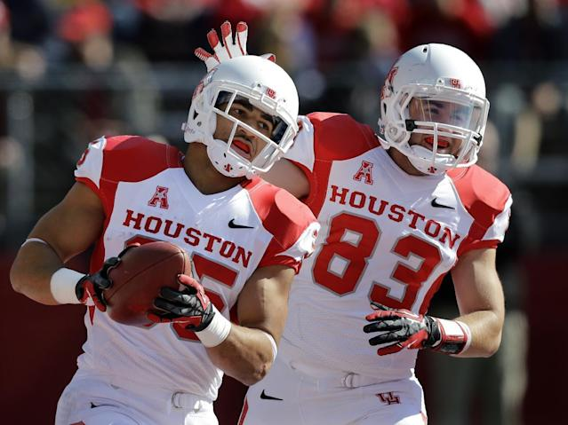 Houston wide receiver Andrew Rodriguez (83) celebrates a touchdown by running back Kenneth Farrow (35) during the first half of an NCAA college football game against Rutgers, Saturday, Oct. 26, 2013, in Piscataway, N.J. (AP Photo/Mel Evans)