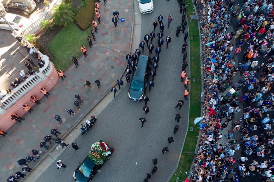 <p>The hearse carrying the casket of Diego Maradona leaves the government house in Buenos Aires</p>AP