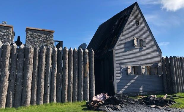 Half the roof and most of the side of this building, part of a recreation of the historic Fort La Tour in Saint John, were destroyed by fire early Wednesday.  (Julia Wright/CBC - image credit)