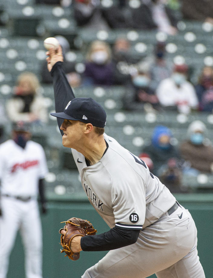 New York Yankees starting pitcher Jameson Taillon delivers against the Cleveland Indians during the first second inning of a baseball game in Cleveland, Sunday, April 25, 2021. (AP Photo/Phil Long)