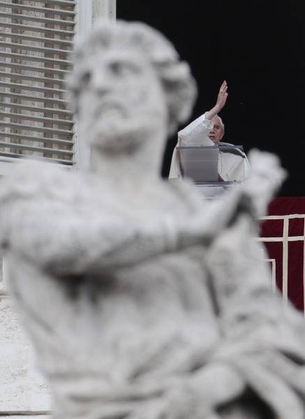 Pope Benedict XVI delivers a blessing during the Regina Coeli prayer from his studio's window overlooking St. Peter's square at the Vatican, Sunday, April 15, 2012. (AP Photo/Gregorio Borgia)