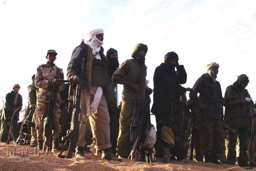 A handout picture released by the Azawad National Liberation Movement (MLNA) on taken in February shows MNLA fighters in Mali. Tuareg rebels, militias and Islamist groups are committing war crimes in Mali's lawless north, including summary executions and rapes, Human Rights Watch says