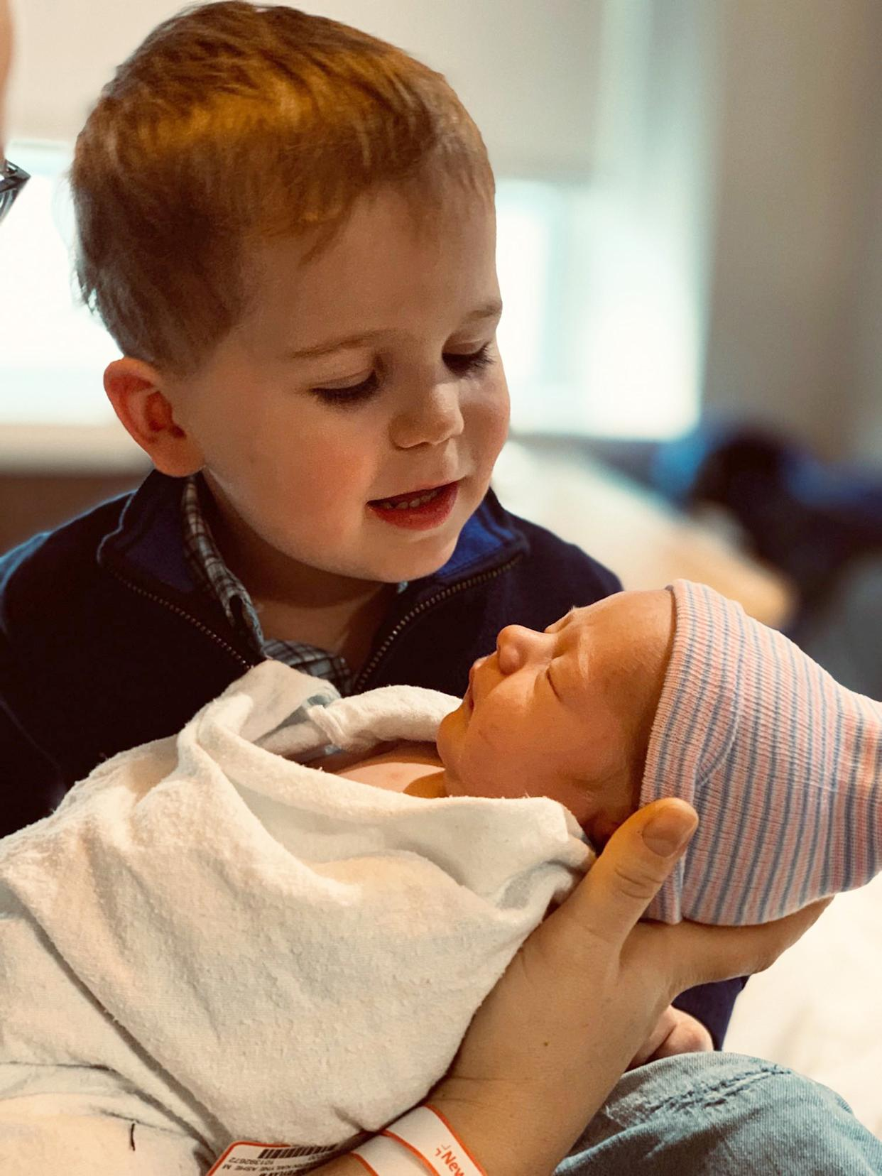 Calvin holding his baby brother, Oliver George