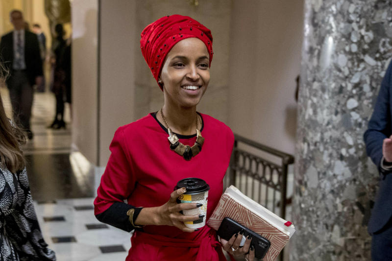 In this Jan. 16, 2019 file photo, Rep. Ilhan Omar, D-Minn., center, walks through the halls of the Capitol Building in Washington. (AP Photo/Andrew Harnik)