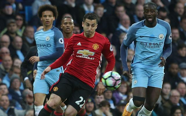 <span>Henrikh Mkhitaryan in action against Manchester City</span>