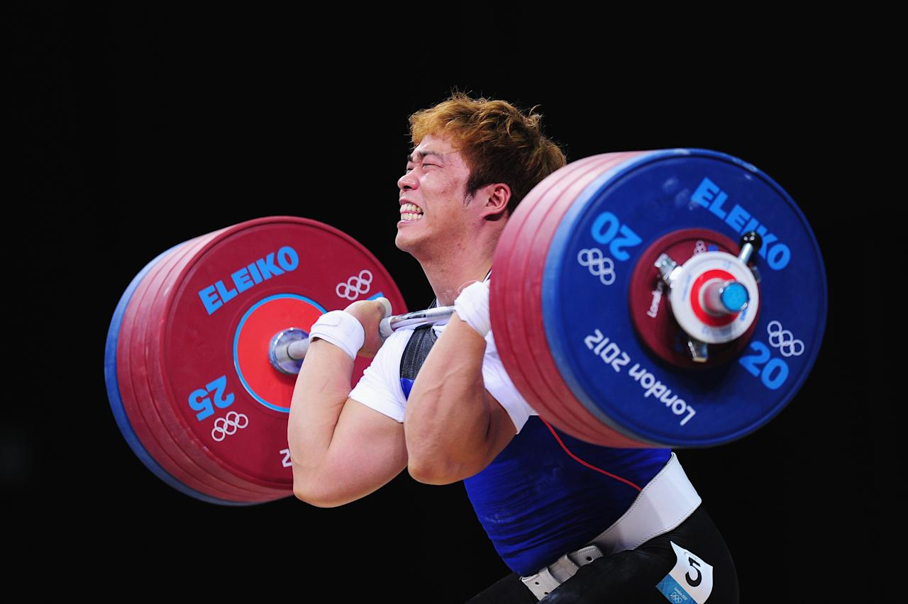 LONDON, ENGLAND - AUGUST 04:  competes in the Men's 94kg Weightlifting final on Day 8 of the London 2012 Olympic Games at ExCeL on August 4, 2012 in London, England.  (Photo by Mike Hewitt/Getty Images)