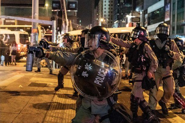 PHOTO: Riot police uses pepper spray in Mongkok district against protesters, Oct. 13, 2019 in Hong Kong. (Anthony Kwan/Getty Images)