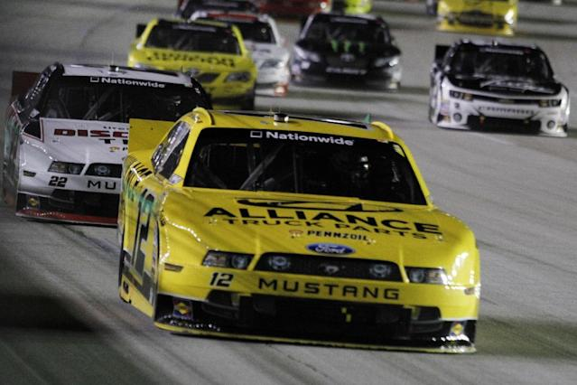 Sam Hornish Jr. leads during an early lap of the NASCAR Nationwide Series auto race, Saturday, Sept. 21, 2013, at Kentucky Motor Speedway in Sparta, Ky. (AP Photo/James Crisp)