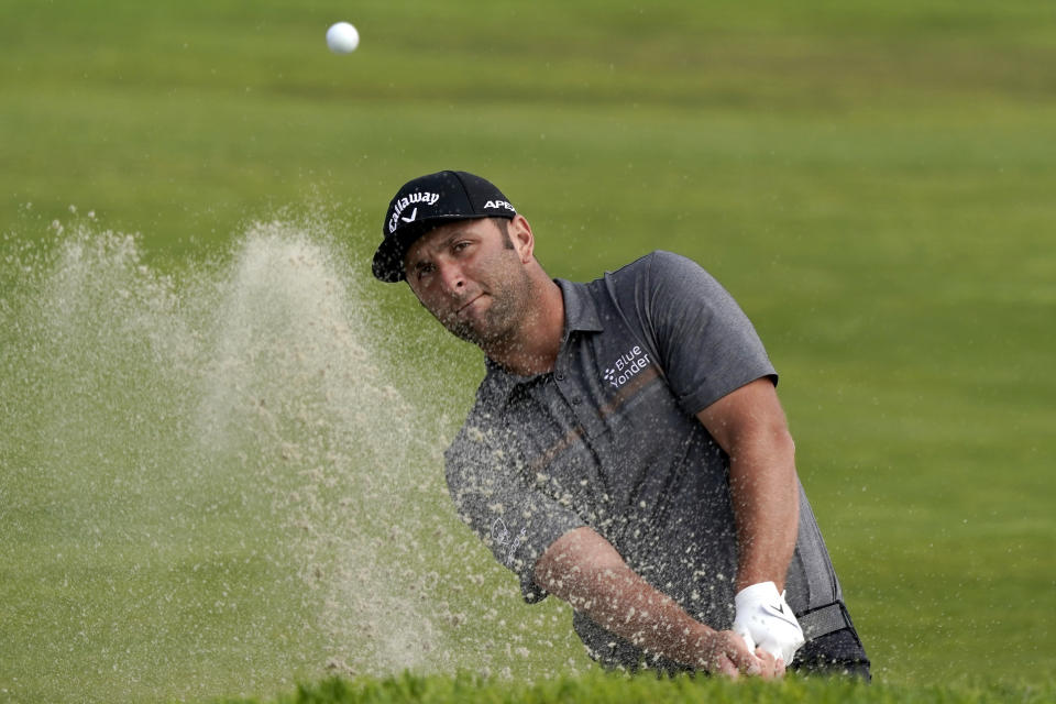 Jon Rahm, of Spain, plays a shot from a bunker on the 15th hole during the first round of the U.S. Open Golf Championship, Thursday, June 17, 2021, at Torrey Pines Golf Course in San Diego. (AP Photo/Marcio Jose Sanchez)