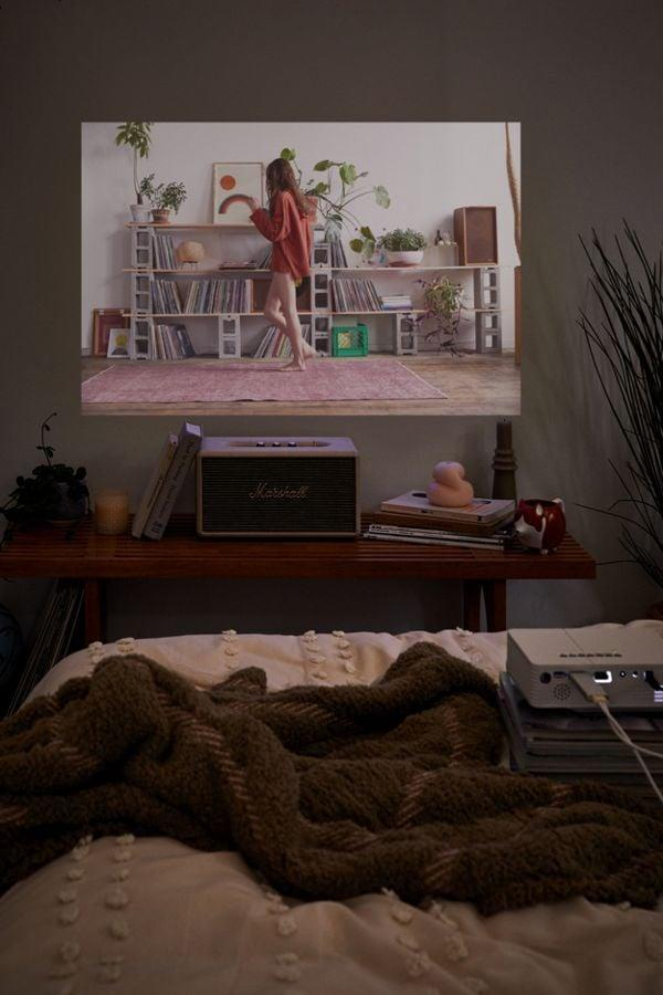 """<p>Watch your favorite movies and tv shows anytime, anywhere with this <a href=""""https://www.popsugar.com/buy/Audiology-Connect-Portable-Projector-526470?p_name=Audiology%20Connect%20Portable%20Projector&retailer=urbanoutfitters.com&pid=526470&price=90&evar1=savvy%3Aus&evar9=45252636&evar98=https%3A%2F%2Fwww.popsugar.com%2Fphoto-gallery%2F45252636%2Fimage%2F46972859%2FAudiology-Connect-Portable-Projector&list1=shopping%2Cgifts%2Choliday%2Cgift%20guide%2Cgifts%20for%20women%2Cgifts%20for%20men&prop13=api&pdata=1"""" rel=""""nofollow"""" data-shoppable-link=""""1"""" target=""""_blank"""" class=""""ga-track"""" data-ga-category=""""Related"""" data-ga-label=""""https://www.urbanoutfitters.com/shop/audiology-connect-portable-projector?category=lifestyle&amp;color=010"""" data-ga-action=""""In-Line Links"""">Audiology Connect Portable Projector</a> ($90).</p>"""
