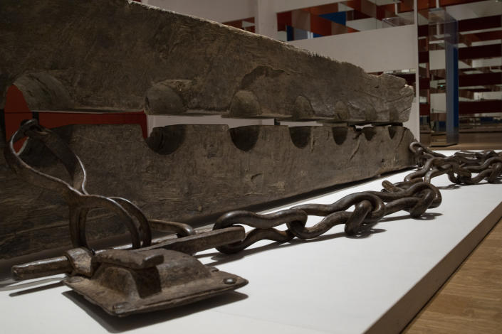 """Tronco, or multiple foot stocks used to to constrain enslaved people, are seen at the Slavery exhibition Rijksmuseum in Amsterdam, Netherlands, Monday, May 17, 2021. The stark contrast between finery and brutality, wealth and inhumanity is a recurring pattern at the museum's unflinching new exhibition titled, simply, """"Slavery"""", that examines the history of Dutch involvement in the international slave trade. (AP Photo/Peter Dejong)"""