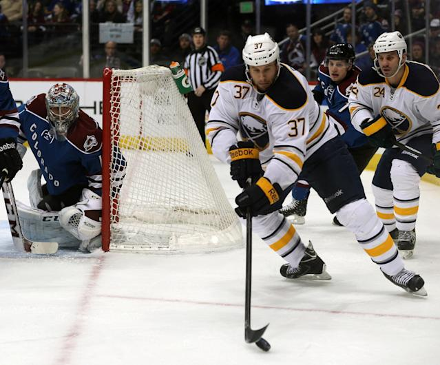 Buffalo Sabres left wing Matt Ellis (37) takes shot on Colorado Avalanche goalie Semyon Varlamov in the first period of an NHL hockey game in Denver, Saturday, Feb. 1, 2014. (AP Photo/David Zalubowski)