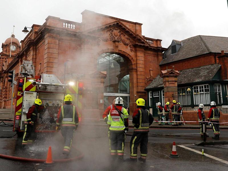 Firefighters attend the scene of the fire at Nottingham Railway Station (Reuters)
