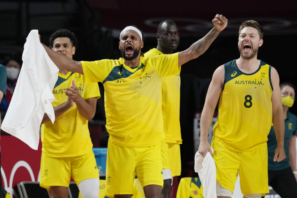 Australia's Patty Mills, left, and Matthew Dellavedova (8) celebrate a score against Argentina during a men's basketball quarterfinal round game at the 2020 Summer Olympics, Tuesday, Aug. 3, 2021, in Saitama, Japan. (AP Photo/Eric Gay)