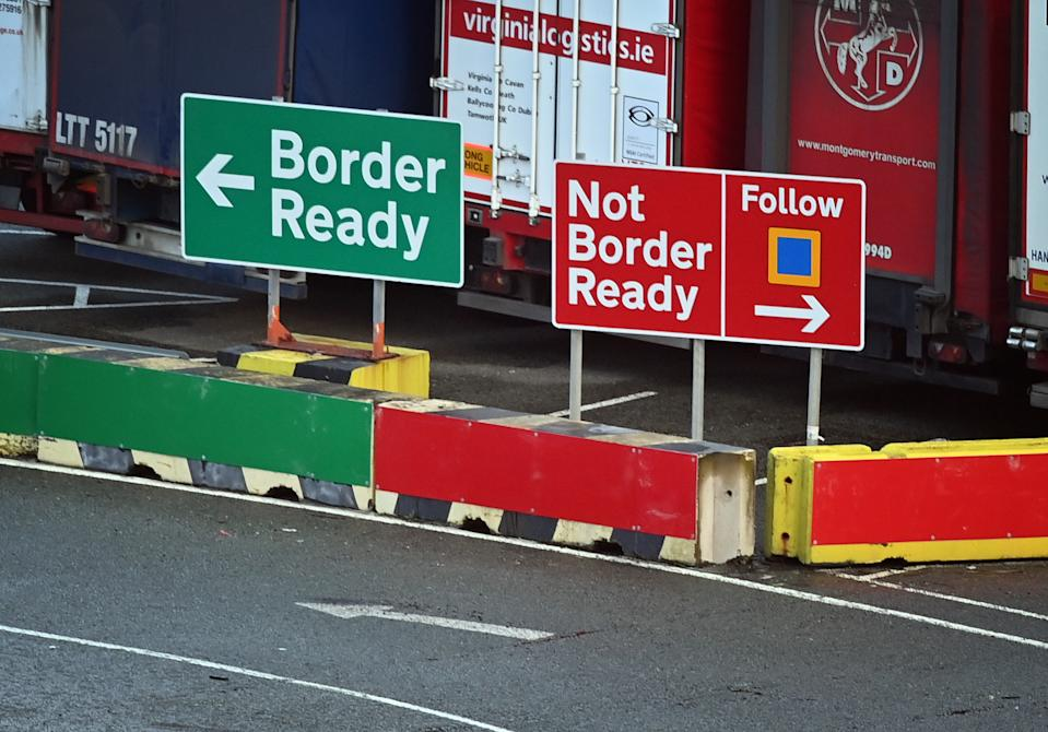 Signage indicates the direction vehicles should follow depending on the relevant paperwork for crossing to Ireland at the check-in area at Holyhead port in Anglesey, north Wales on January 02, 2021. - Britain on Friday began a new year and life outside the European Union's single market, with the first trucks crossing the Channel by ferry and rail largely reporting few difficulties despite new customs rules. (Photo by Paul ELLIS / AFP) (Photo by PAUL ELLIS/AFP via Getty Images)