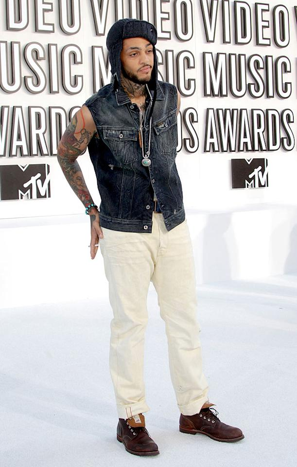 """If Travis McCoy was trying to be edgy, he missed the mark in this hodgepodge of an outfit consisting of white pants, a sleeveless denim vest, knit cap, brown boots, and a turquoise bracelet . Frederick M. Brown/<a href=""""http://www.gettyimages.com/"""" target=""""new"""">GettyImages.com</a> - September 12, 2010"""
