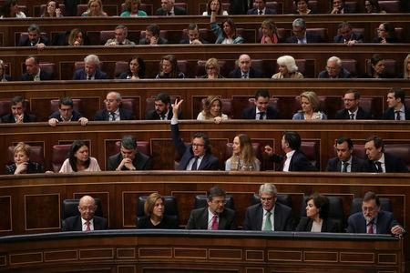 Spain's Prime Minister Mariano Rajoy and Popular Party deputies vote during the budget debate at parliament in Madrid, Spain April 26, 2018. REUTERS/Susana Vera