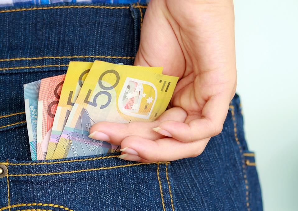 Woman with Australian money in her back pocket.