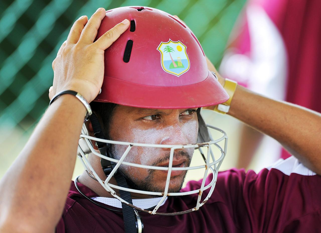 West Indies cricketer Ramnaresh Sarwan puts his helmet during a practice session at the Sir Vivian Richard Stadium in St John's on June 10, 2011. West Indies will face India for the 3rd One Day International at Sir Vivian Richard Stadium on June 11. AFP Photo/Jewel Samad (Photo credit should read JEWEL SAMAD/AFP/Getty Images)