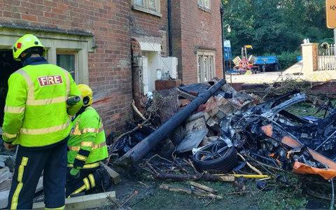 a McLaren 570S supercar crashed into a house on Yarnbrook Road, near Trowbridge, Wiltshire - Credit: Trowbridge Fire Station/PA