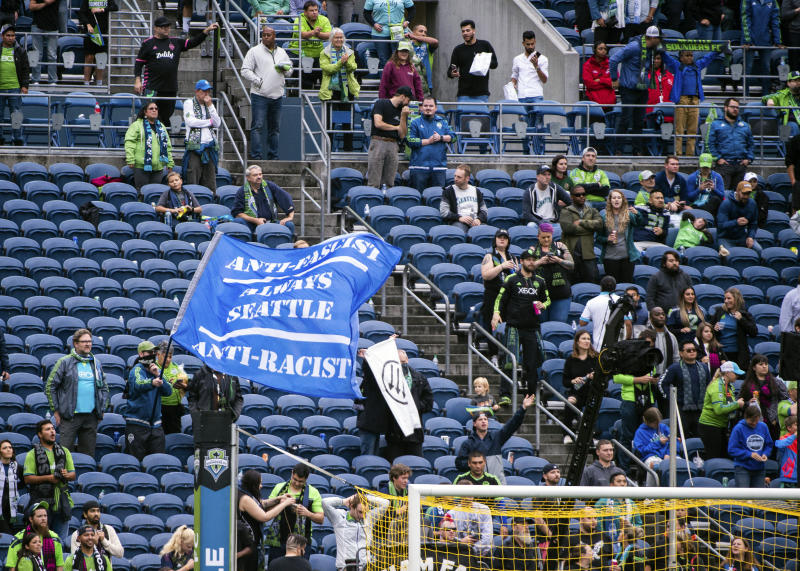 A large section of seats in the Seattle Sounders supporters section are emptied Sunday, Sept. 15, 2019, in the second half of an MLS soccer match against the New York Red Bulls at CenturyLink Field in Seattle, Wash. (Joshua Bessex/The News Tribune via AP).