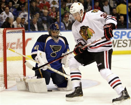 Chicago Blackhawks' Jimmy Hayes (39) looks for the rebound in front of St. Louis Blues goalie Jaroslav Halak (41),of Slovakia, in the first period of an NHL hockey game, Tuesday, March 6, 2012 in St. Louis.(AP Photo/Tom Gannam)