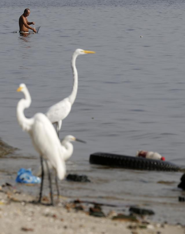 A fisherman works in Fundao beach in the Guanabara Bay in Rio de Janeiro