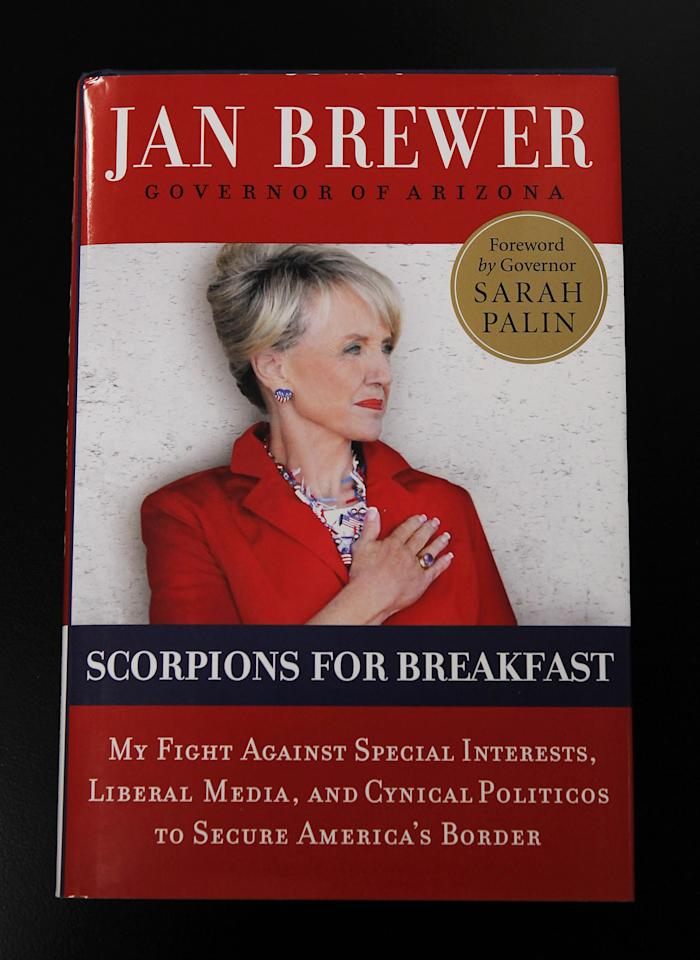 "A copy of Arizona Gov. Jan Brewer's new book ""Scorpions For Breakfast"" taken Wednesday, Oct. 19, 2011, in Phoenix, will be released Nov. 1. The foreword is written by Sarah Palin. (AP Photo/Ross D. Franklin)"
