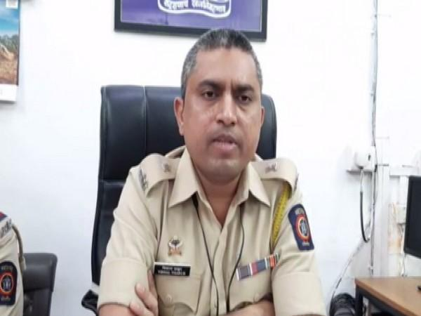 DCP Vishal Thakur speaking to the reporter.