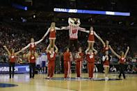 Wisconsin cheerleaders perform during the second half of a second-round game between the Wisconsin and the American in the NCAA college basketball tournament Thursday, March 20, 2014, in Milwaukee. (AP Photo/Jeffrey Phelps)
