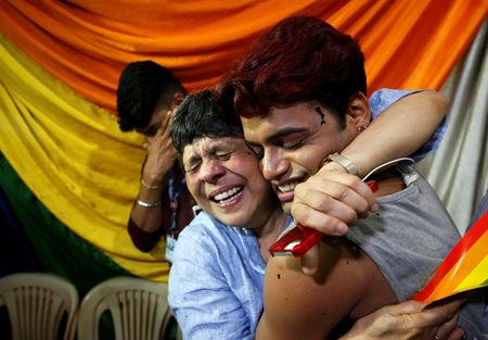 People belonging to the lesbian, gay, bisexual and transgender (LGBT) community celebrate after the Supreme Court's verdict of decriminalizing gay sex and revocation of the Section 377 law, at an NGO in Mumbai, India, September 6, 2018. REUTERS/Francis Mascarenhas