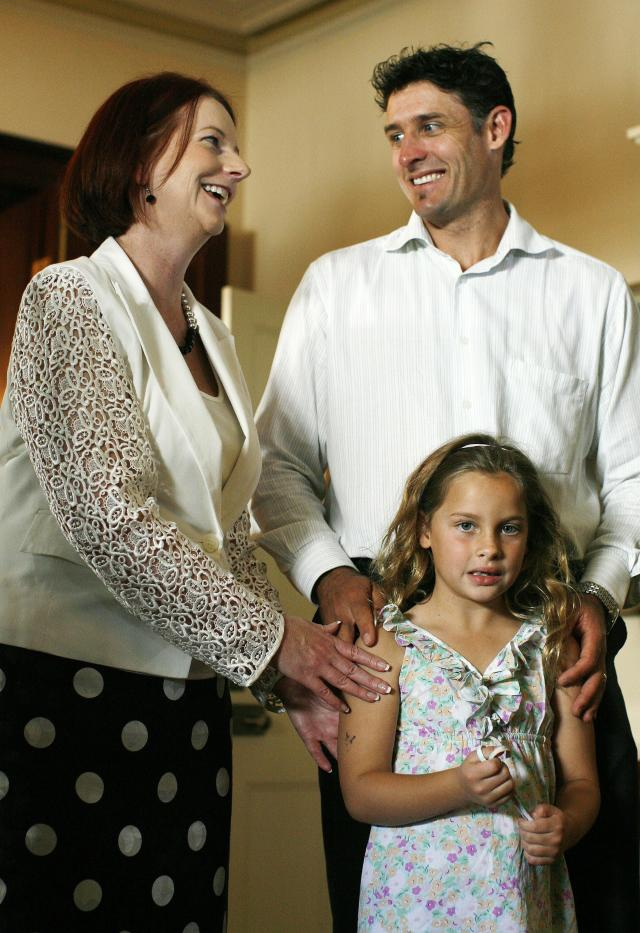 Australian Prime Minister Julia Gillard welcomes Michael Hussey and his daughter Molly during a cricket luncheon held at Kirribilli House in Sydney on January 1, 2011. Prime Minister Julia Gillard invited both the Australian and England team to the luncheon before the final Ashes series begins on January 3. AFP PHOTO / Krystle WRIGHT (Photo credit should read KRYSTLE WRIGHT/AFP/Getty Images)