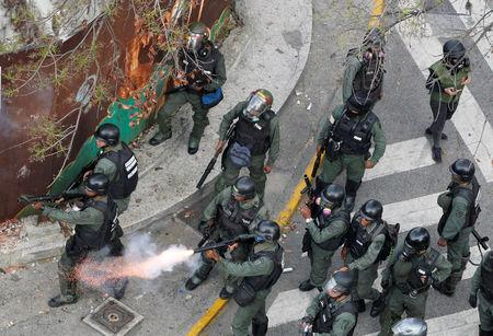 Riot police fire tear gas during a rally against Venezuela's President Nicolas Maduro's government in Caracas